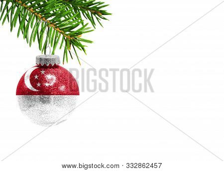 Glass Christmas Ball Toy Isolated On White Background With The Flag Of Singapore