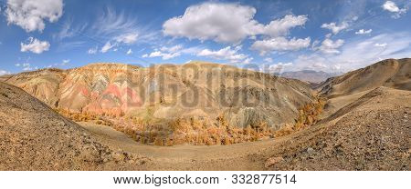 Amazing Autumn Panorama With Mountains Of Colorful Rocks With Cracks And Kinks And A River Valley Wi