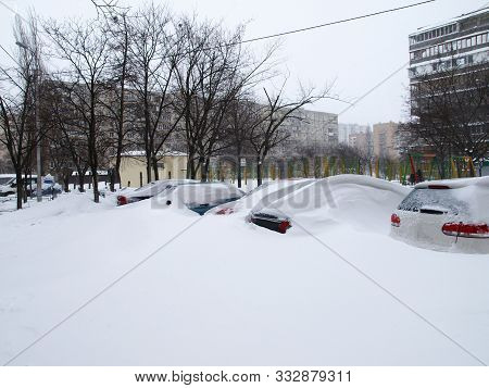 Kiev, Ukraine -  Marсh 23, 2013: Winter In Town. Traffic Paralyzed. Frozen And Snow Covered Automobi