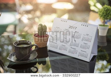 Calendar Year 2020,cactus Pot,note Pap And Cup Of Coffee On Table With Boke Background In Cafe,worki
