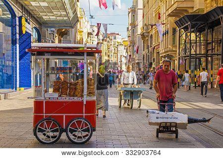 Istanbul, Turkey - September 9th 2019. Istiklal Cadessi In Istanbul. A Street Vendor Cart Sells Bagu