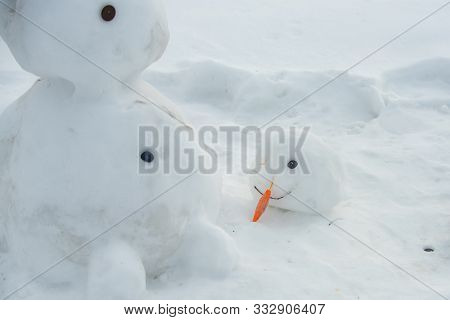Melted Snowman In Puddle. Bad Warm Rainy Winter Weather. Snowman In Our Yard. Is My First Snowman. L