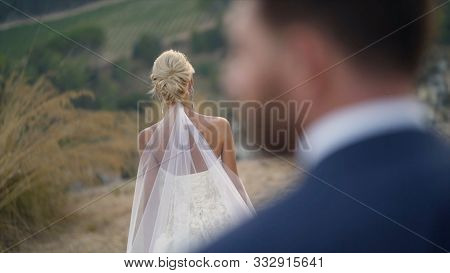View From Back Of Groom To Beautiful Bride. Action. Close-up Of Couple Of Newlyweds In Thought Befor