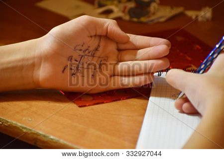 Cheat Sheet On The Hand. Formula Written In The Palm Of A Schoolboy. Hint In The Palm Of Your Hand.