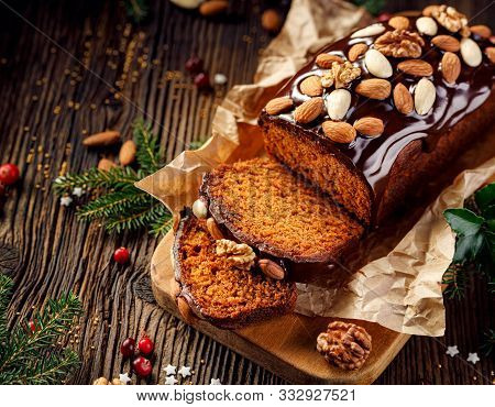 Gingerbread Cake, Christmas Gingerbread Cake Covered With Chocolate And Decorated With Nuts And Almo