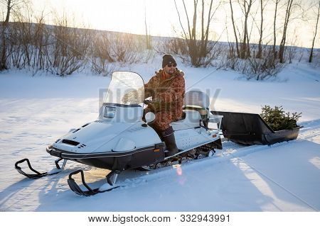 Kemerovo, Russia - 23.02.2019: Rider On The Snowmobile In Nature Of Siberia In Russia
