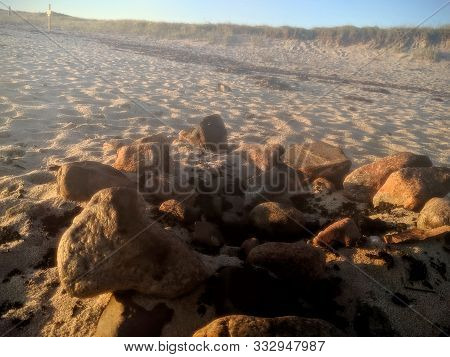 Sunrise On Yesterdays Beach Campfire With A Circle Of Rocks