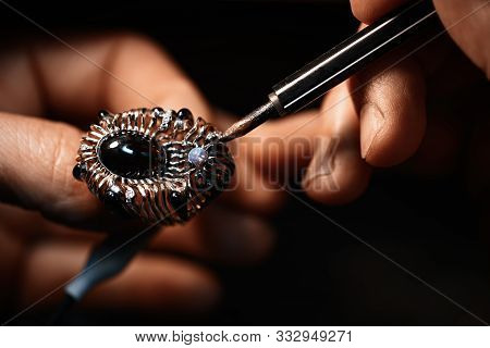 A Jeweler Is Treating A Rhodium The Gold Ring.