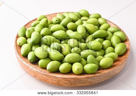 Fresh Green Olives With Branches And Leaves. Seasonal Harvest In Italy. Top View