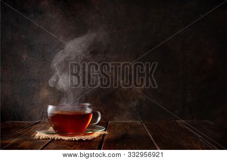 Cup Of Hot Tea With A Steam On Dark Background