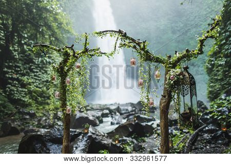Unusual Wedding Ceremony Arch With Waterfall View In Jungle Rainforest. Dream Wedding Ceremony In Ba