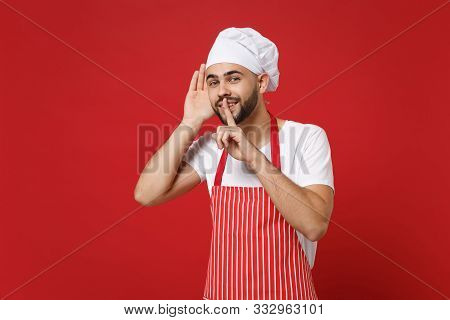 Bearded Male Chef Cook Or Baker Man In Striped Apron Toque Chefs Hat Posing Isolated On Red Backgrou