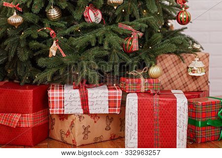 Festive Boxes With Gifts Under The Christmas Tree. New Year Home Decoration.