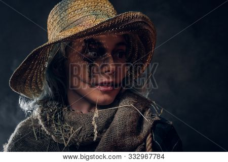 Evil Creepy Scarecrow Concept - Young Woman In Mist And Smoke Is Posing For Photographer.