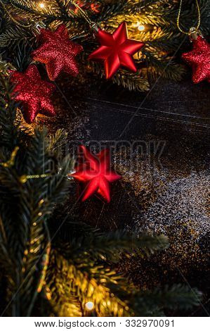 Christmas Background With Xmas Tree, Red Stars And Glowing Golden Bokeh Lights On Background. Merry