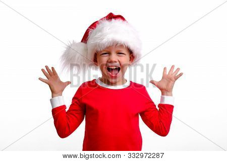 Do Not Miss. Wow. Little Blonde Boy In Red Christmas Costume And Santa Hat Is Happy Shouting. Shout.