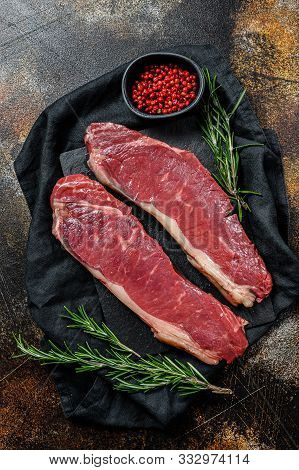 Raw Ramp Steak, Fresh Meat, Marbled Beef. Dark Background. Flat Lay