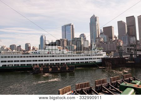 Seattle Waterfront Skyline With A Ferry Boat In The Puget Sound Docked Downtown In The Travel Citysc