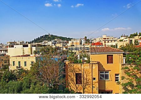 Colorful View Of The Philopappos Monument On Filopappou Hill And The City Of Athens, Greece With Ple