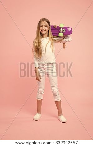 Girl Likes To Ride Skateboard. Active Leisure Of Fashion Girl. Girl Having Fun With Penny Board Pink