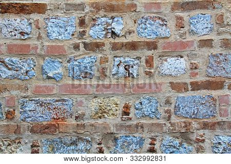 Background Texture Of A Typical Building Wall Of Brick And Stone In Athens, Greece.
