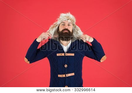 Man Mature Bearded Stand Warm Jumper And Hat On Red Background. Winter Season Menswear. Hipster Rust