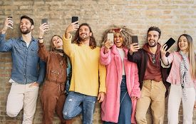 Happy Group Friends Taking Selfie With Cell Phone Outdoor - Young Trendy People Having Fun With New