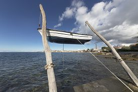 Hanging Boat On The Beach In Front Of The Town Of Umag, Istria, Croatia