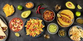 A Panorama Of Mexican Food, Many Dishes Of The Cuisine Of Mexico, Flat Lay, Overhead Shot On A Black