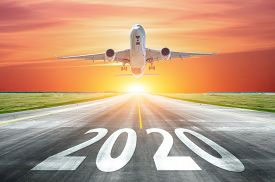 The Inscription On The Runway 2020 Surface Of The Airport Runway With Take Off Airplane. Concept Of