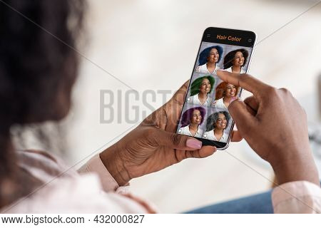 Black Lady Checking Hair Color Simulation Mobile App On Smartphone