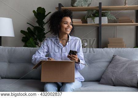 Teen Black Female Blogger Plan Shooting Parcel Unpacking On Phone
