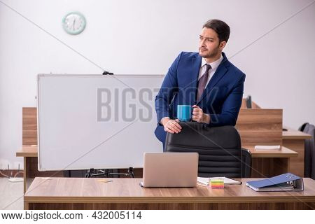 Young handsome employer in teleconference concept