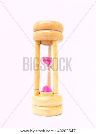 A Wooden Sand Watch With Pink Sand Isolated On White Background
