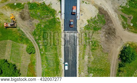 Above Top View, Overhead, On Several Steamrollers As Flatting Fresh Asphalt, Spreading Layer Of Hot