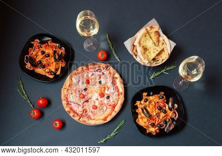 Seafood Pizza, Plates Of Pappardelle Pasta With Seafood With Tomato Sauce,  Glasses Of White Wine An