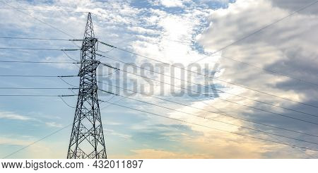 High Voltage Pillar. Power Grid Pole Against The Sky. High Voltage Tower. Electricity Use And Electr