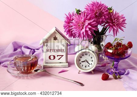 Calendar For September 7 : The Name Of The Month In English, Cubes With The Numbers 0 And 7, A Bouqu
