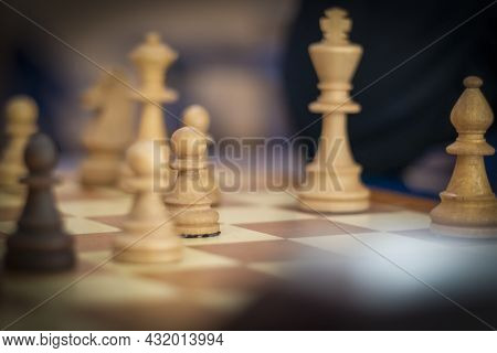 Room Lighting. The Chess Piece Is Black In Color And White In Color. Chessboard.