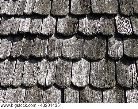 Roof Shingles As A Traditional Rural Roof Covering. Tiled Acute Angled Cross Slab Roofing Piece Mate