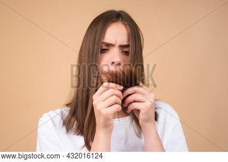 Woman With Hair Problem. Woman Is Looking Shocked To Her Lost Hair. Head Bald And Hair Treatment Con