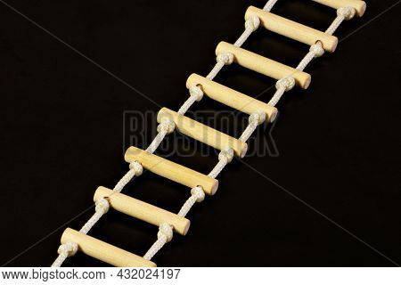 Rope Ladder. On A Black Background. Simple And Reliable Inventory, Use In Critical Situations For Re