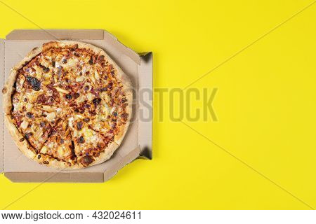 Tasty Hawaii Pizza In A Box Isolated On Yellow Top View On Paperoni Pizza. Concept For Italian Food,