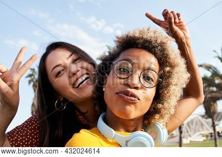 Couple Of Friends Or Girlfriends Take A Picture With Their Cell Phone, Playing The Fool. Concept Of