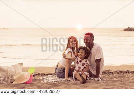 Image Of Young Happy Family Outdoors At The Beach Take A Selfie By Camera. Portrait Of Multiracial F