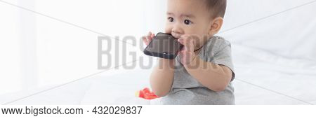 Portrait Of Cute Little Baby Girl Sitting With Cozy On Bed At Bedroom, Happiness Of Toddler, Newborn