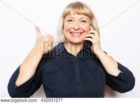 Photo of crazy ecstatic old woman use smartphone impressed social media like feedback win raise fists scream yes isolated over white background