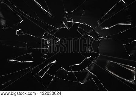 Broken Glass With Cracks On Black Background