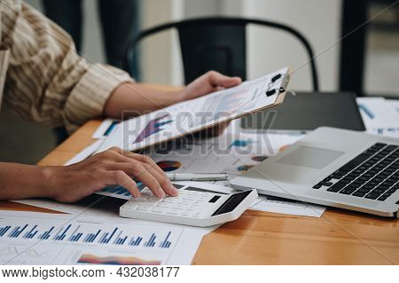 Close Up View Of Bookkeeper Or Financial Inspector Hands Making Report, Calculating Or Checking Bala