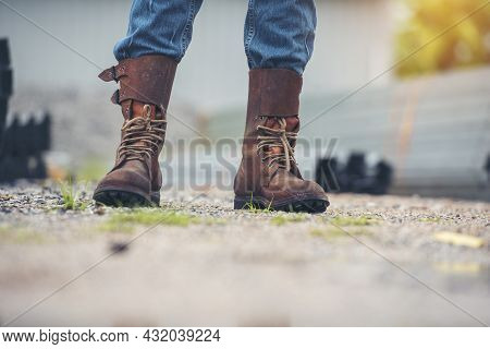 Men Wear Construction Boots Safety Footwear For Worker At Construction Site. Engineer Wear Jeans Bro